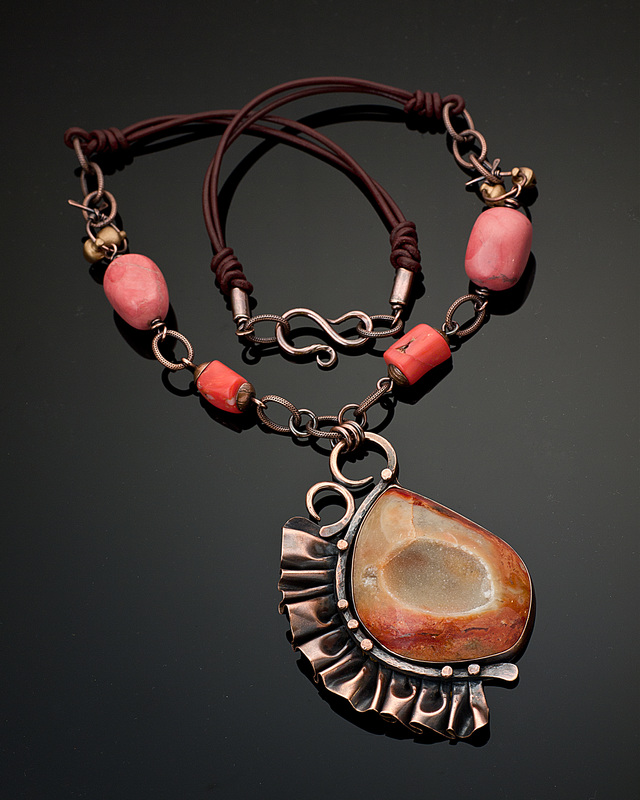 "Kharisma Sommers, Quincy, IL, U.S., ""Frilly Peach"" (8.9 cm H focal) (3.5 in) Copper, drusy agate, marble and coral beads, bronze bells, leather -- www.foldforming.org"