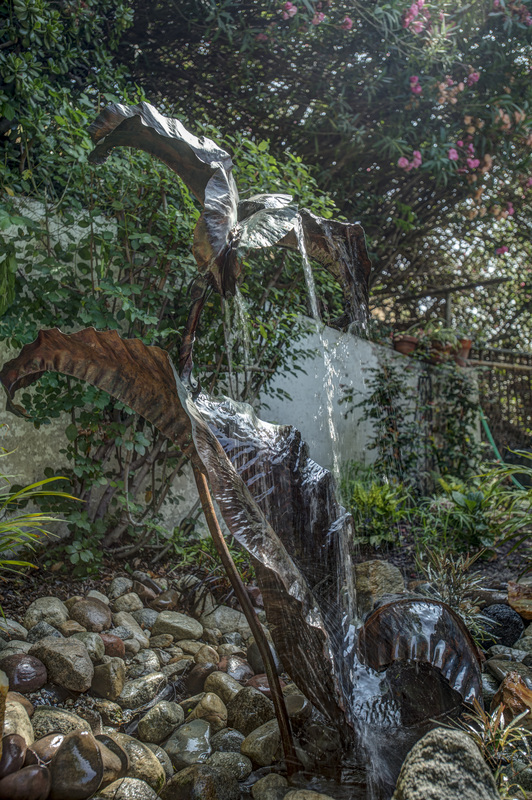 "Heather McLarty, Los Angeles, CA, U.S., ""Strange Fountain"" ​(53 x 37 x 30 in) (1.3 x .9 x .8 meters) Copper, steel tubing, fountain parts, stone, photo by Martha Benedict -- www.foldforming.org"